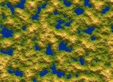 Top view of green mountainous island in sea water Royalty Free Stock Image