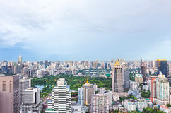 Top view of green park in big city at twilight, Bangkok Thailand. Green park in big city at twilight, Bangkok Thailand Royalty Free Stock Photo