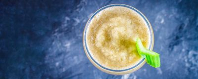 Top view. Green smoothie with celery, banana and apple.  Stock Photo