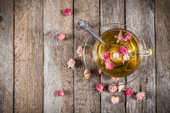 Top view of green tea cup with dried roses Royalty Free Stock Image