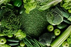 Top view of green vegetables and fruits on grass, healthy eating concept royalty free stock photography