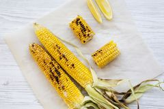 Top view, grilled corn on the cob with salt and slices of lemon. Summer food. Closeup. From above, flat lay. Overhead royalty free stock image