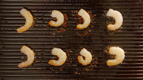TOP VIEW: Grilled king prawns on a grill Stock Photo