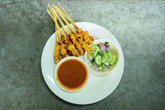 Top view Grilled Pork Satay with Peanut Sauce pickles which are royalty free stock photos