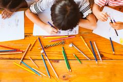 Top view of group asian children drawing and painting. With crayon together with fun stock photography