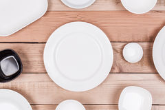 Top View Group of Empty Dish On Wood Background Textured Royalty Free Stock Photography