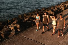 Top view of group fitness people walking on pier. Top view of group of fitness people walking on pier near the sea royalty free stock photo