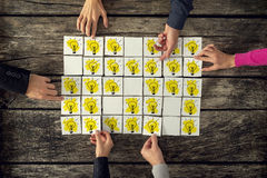 Top view of a group of many scientists each holding a card with Stock Image