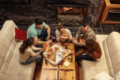 Top view of group of people having pizza party in the room Stock Image