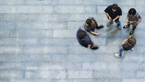 Top view group of people are playing and talking with phone. Top view group of people are playing and talking with the smart phone on the concrete pedestrian Royalty Free Stock Photos