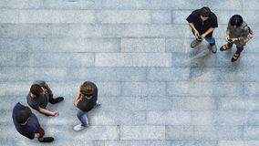 Top view group of people are playing and talking with phone. Top view group of people are playing and talking with the smart phone on the concrete pedestrian Royalty Free Stock Image