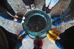 Top view of a group of seven friends in multi-colored shoes. royalty free stock photos