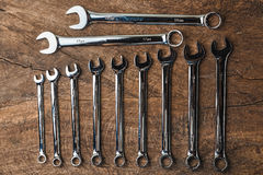 Top view of group of wrench arrange on wooden rustic background. Flat lay with copy space for mechanic tools concept Royalty Free Stock Images