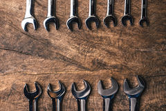 Top view of group of wrench arrange on wooden rustic background. Flat lay with copy space for mechanic tools concept Stock Images