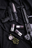 Top view of gun, knife, rifle, compass and shell casings. Weapon on black cloth: gun, knife, rifle, compass and shell casings,top view stock photos