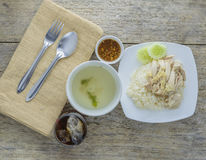 Top view,Hainanese chicken rice. On wood Stock Images