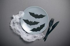 Top View of Halloween Plate with Bats on Dark Background, Halloween Party Dinner Concept stock images