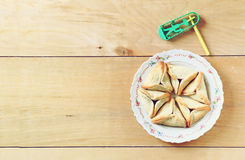 Top view of Hamantaschen cookies or hamans ears and noisemaker for Purim celebration (jewish holiday) Stock Image