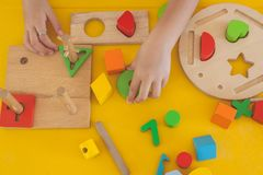 Top view hand of cute little girl playing kids toys in childhood room. Selective focus Stock Photography