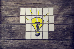 Top view of hand drawn yellow light bulb assembled with many car Royalty Free Stock Photography