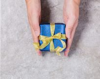 Gift box on gray background royalty free stock image