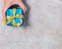 Gift box on gray background royalty free stock images