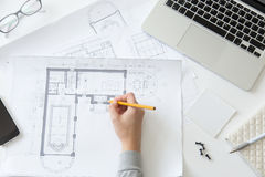 Top view of a hand making an architect drawing Royalty Free Stock Photos