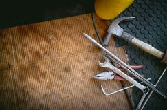 Top view hand tools on a dirt paper in rustic style,copy space royalty free stock image