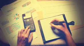 Top view of hand woman writing make note and calculate doing fin stock images