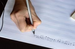 Music notes writing composer creating musician art. Top view of the hand writing the music notes with pencil. The concept of the music creating, composing, note royalty free stock photos