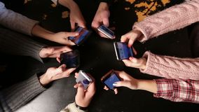 Top view hands circle using smart phones in cafe. stock video footage