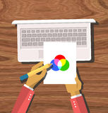 Top view Hands Hold Color Model. Top view element designer programmer hands hold color model and laptop flat design on wood background. Design concept. Hands Stock Photo