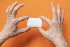 Top view of hands holding a soap bar, hygiene concept isolated d royalty free stock photography