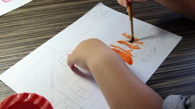 Top view of hands little girl painting and using watercolor paints stock video footage