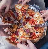 Top view of hands taking pizza Royalty Free Stock Photography