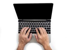 Top view of hands typing on computer laptop on white isolated background with clipping path. Top view of hands typing on computer laptop on white isolated stock images