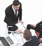 Top view.handshakes of business partners on the Desk.  royalty free stock images