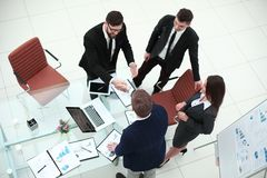 Top view.handshakes of business partners on the Desk.  stock photography
