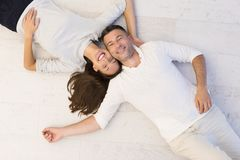 Handsome couple lying on floor Royalty Free Stock Photos