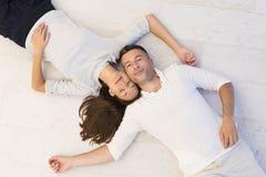 Handsome couple lying on floor Stock Image