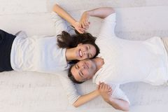 Handsome couple lying on floor Royalty Free Stock Image