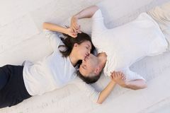 Handsome couple lying on floor Stock Images