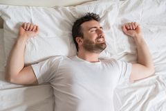 Man , bedtime and rest concept . Man lying in bed at home Stock Photo