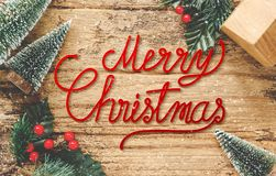 Top view of handwriting red Merry Christmas on rustic wooden tab stock image