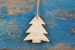 Top view of hanging carved pine tree on wooden background for ch Royalty Free Stock Photo