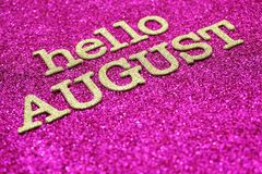 Happy august alphabet letters on pink glitter background