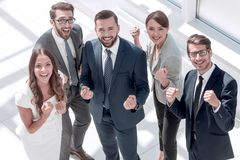 Top view.happy business team showing their success. Winning concept royalty free stock photo