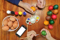 Top view of happy christian family time during prepare eggs for easter day Stock Photo
