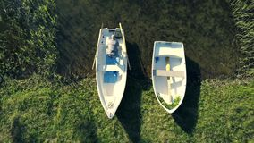 Top view of happy couple in a boat on lake. stock video