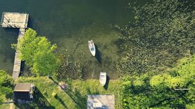 Top view of happy couple in a boat on lake. stock video footage